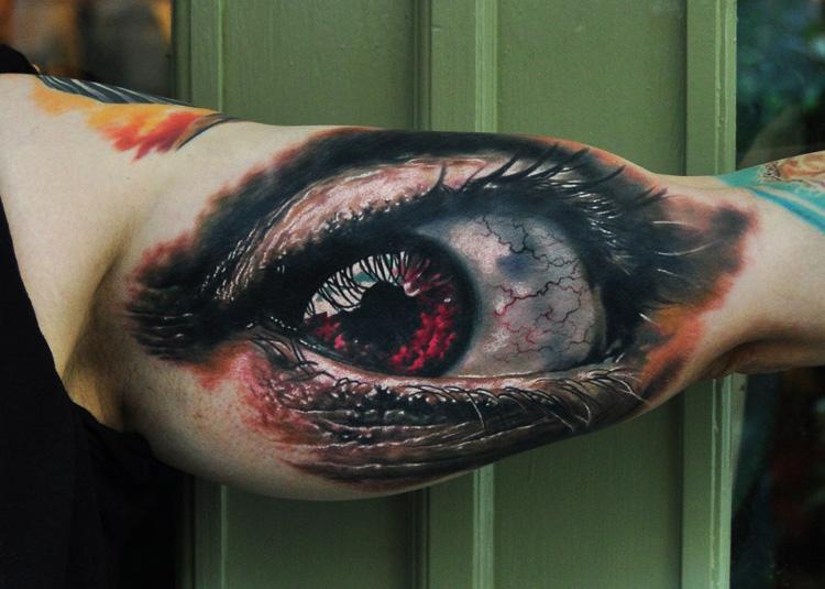 Biceps Eye realistic tattoo