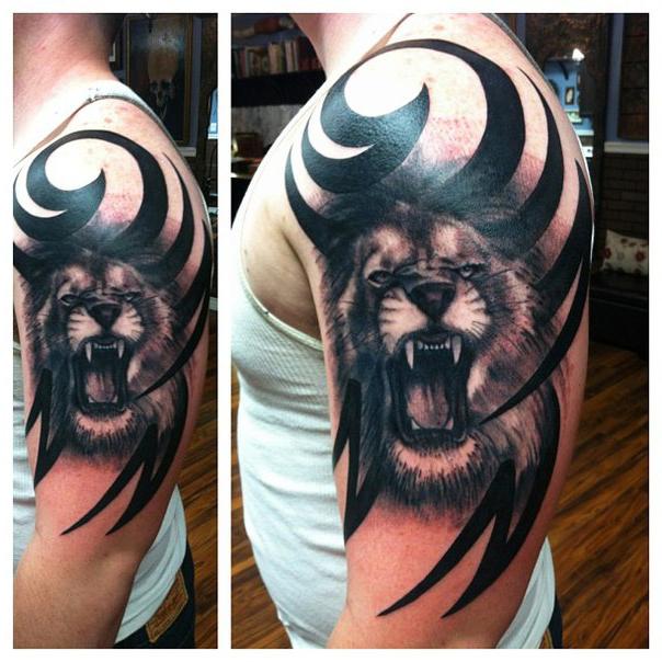 Shoulder growling lion tribal tattoo