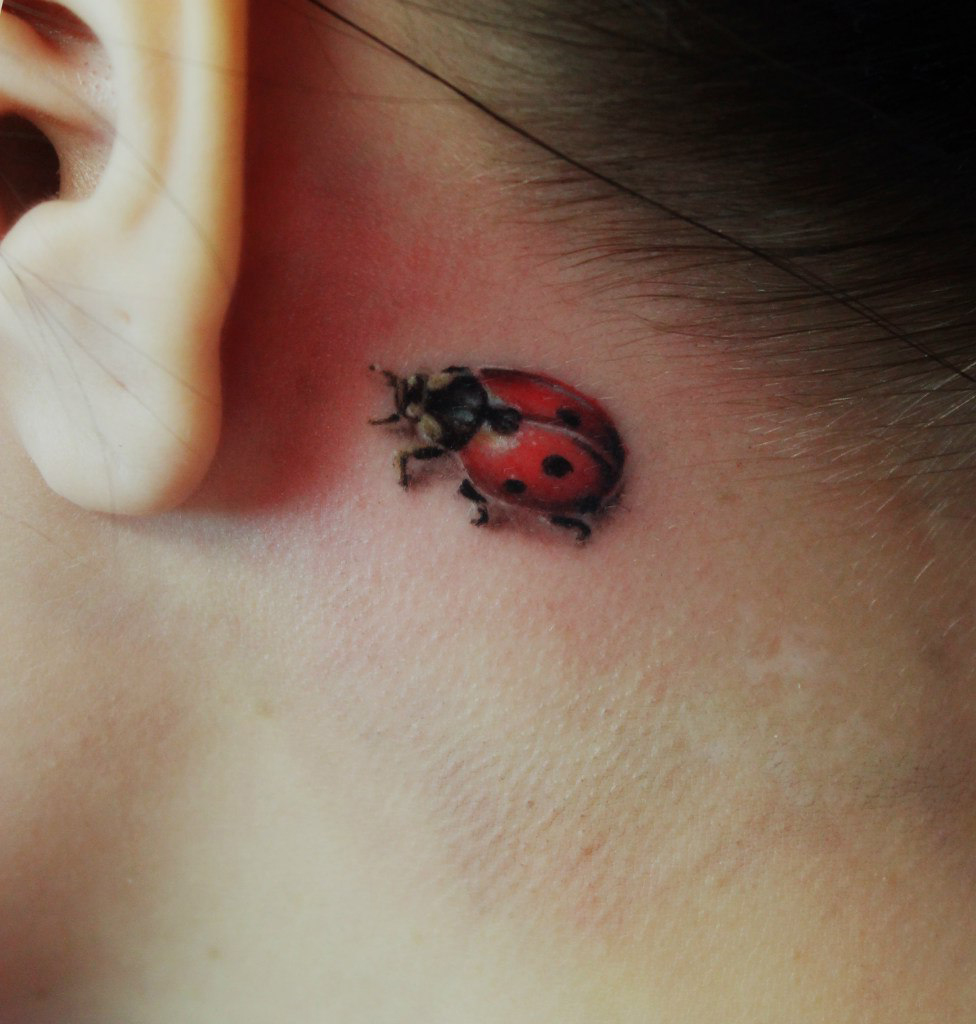 Tiny Ladybug Behind the Ear 3D tattoo