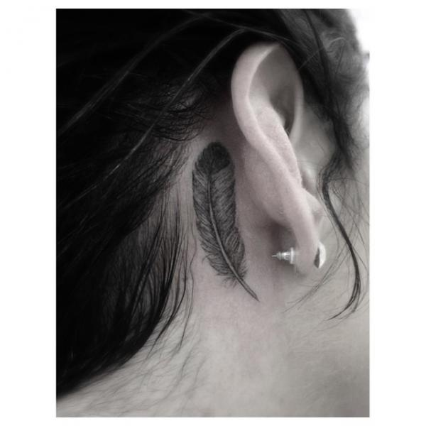 Cool Feather tattoo behind Ear by Dr Woo
