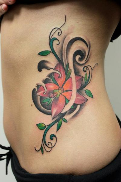 Abstract Flower tattoo by Tantrix Body Art
