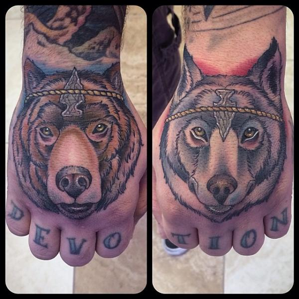 Back of Hand Bear and Wolf tattoo by Earth Gasper Tattoo