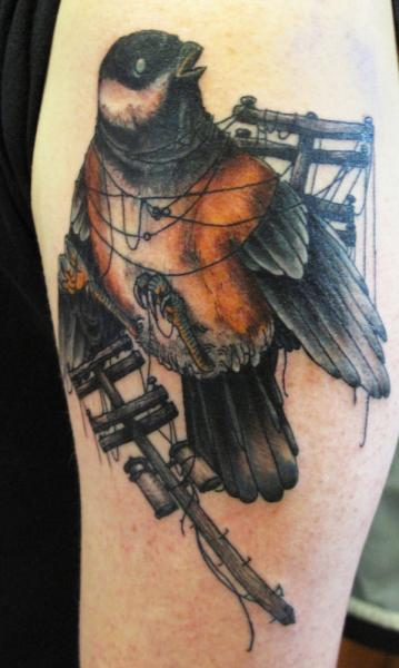 Bird Caught in Wires Realistic tattoo by Three Kings Tattoo