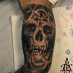 Blackwork Biceps Skull tattoo by Agat Artemji