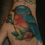 Blue Bird on Back of Hand tattoo by Three Kings Tattoo