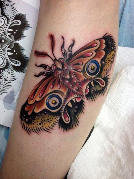 Creepy Face Moth Wings tattoo by Tantrix Body Art