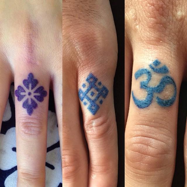 Finger Symbols tattoos by Kat Blackstone
