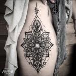 Dotwork Flower Symmetry tattoo on Hip