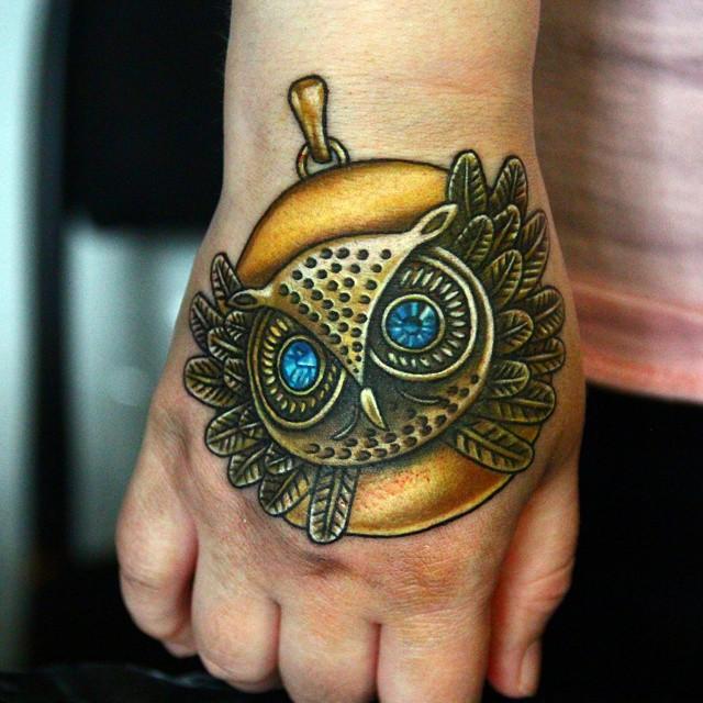Metal Golden Owl Hand tattoo