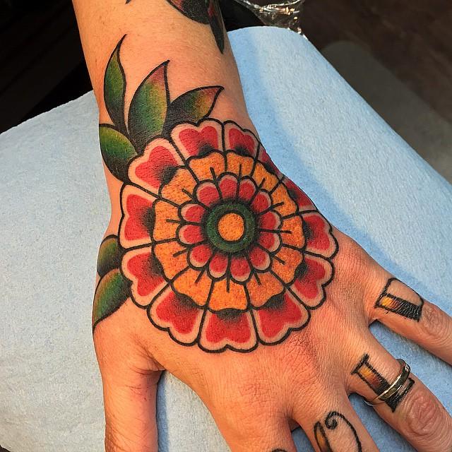 Great Flower Hand Tattoo