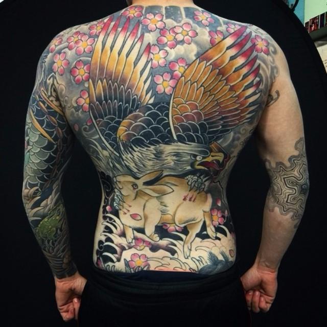 Hare Holding Eagle Full Back tattoo