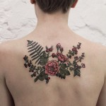 Pretty Flowers and Berries tattoo on Back