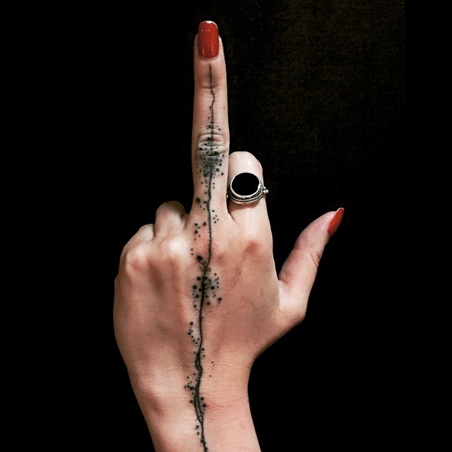 Splashed Line Middle Finger tattoo