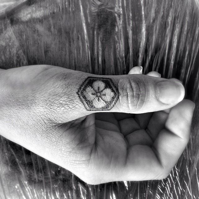 Thumb Finger Trefoil tattoo