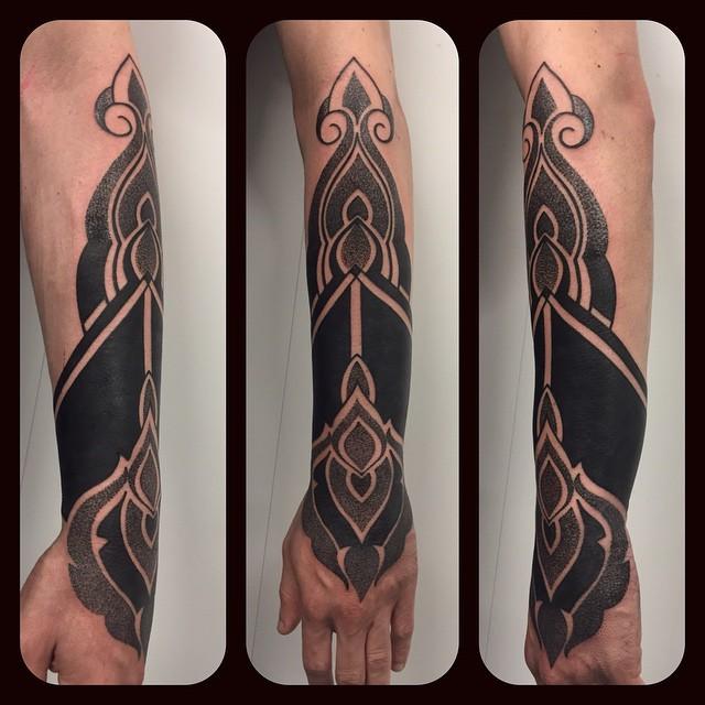 Black and Dotwork Arm Tattoo