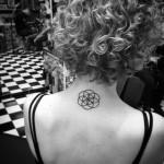 Circles on Circles Back Neck Tattoo
