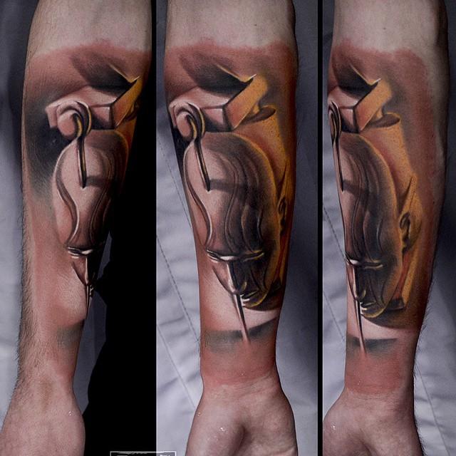 Nailed Puppet Head Tattoo on Arm