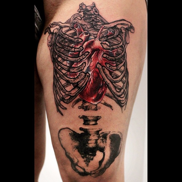Ribcage Hear Tattoo on Thigh