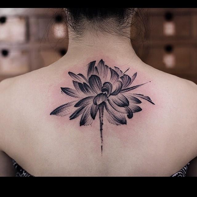 Uneven Brush Lotus Tattoo on Back