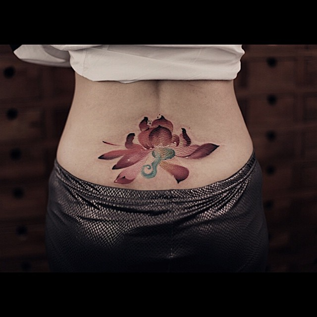 Watercolor Lotus Lower Back tattoo
