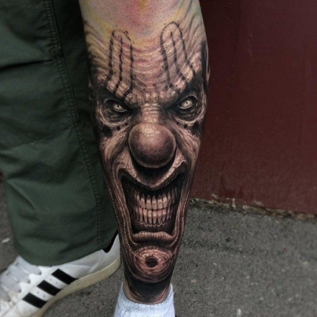 Wrinkled Evil Clown Tattoo on Shin