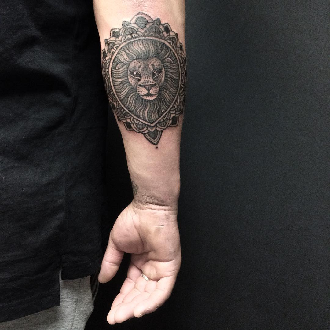 Lion Arm Tattoo