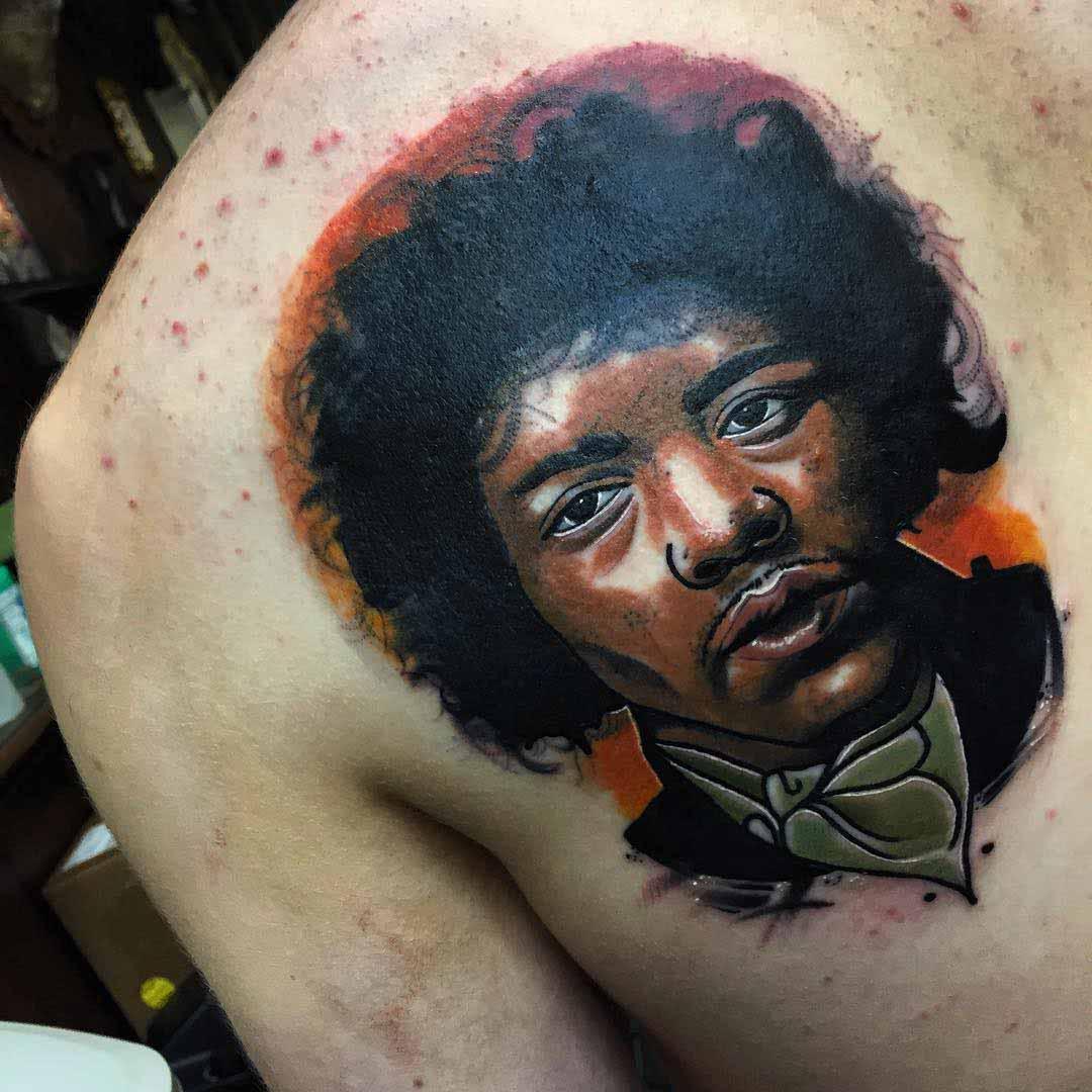 a shoulder blade tattoo potrait of Jimi Hendrix