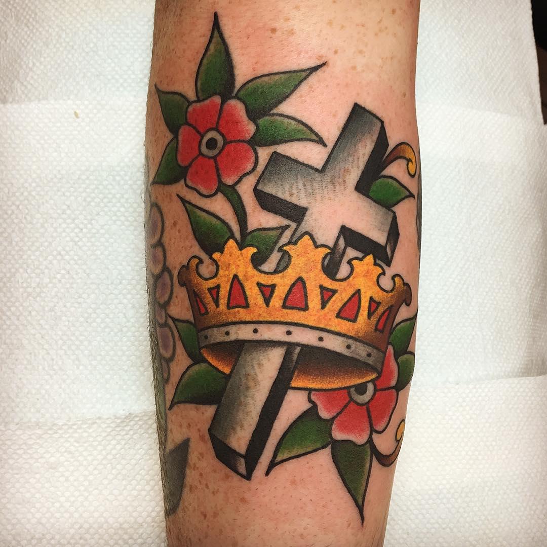 a croun tattoo with crucifix has some definite religious sense