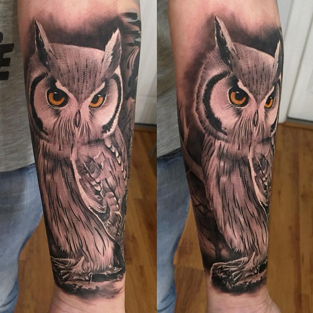cool realistic owl tattoo on arm