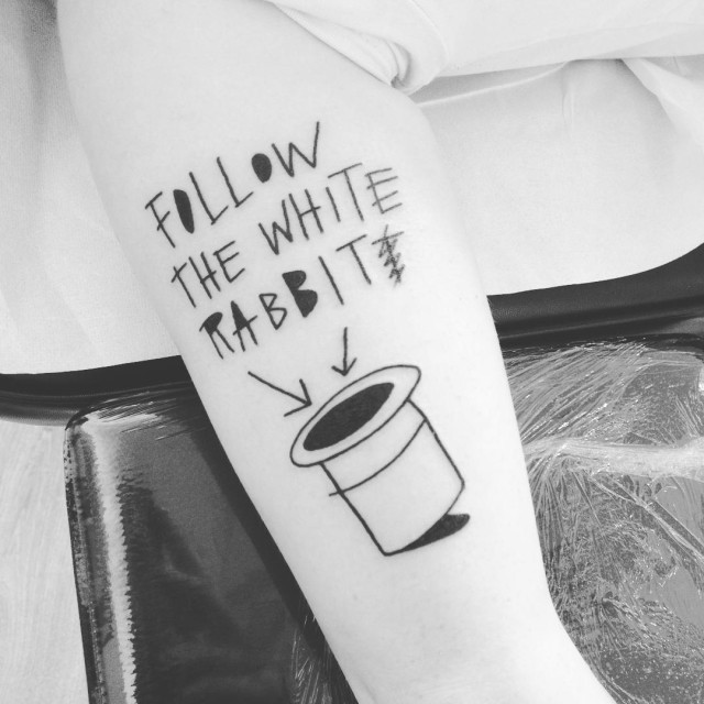 a tattoo lettering from Alice in Wonderland