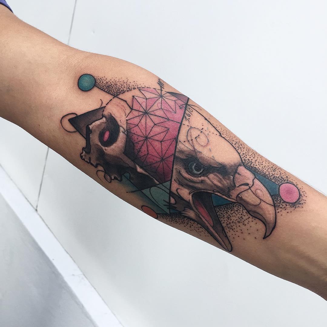 skull and eagle tattoo on arm