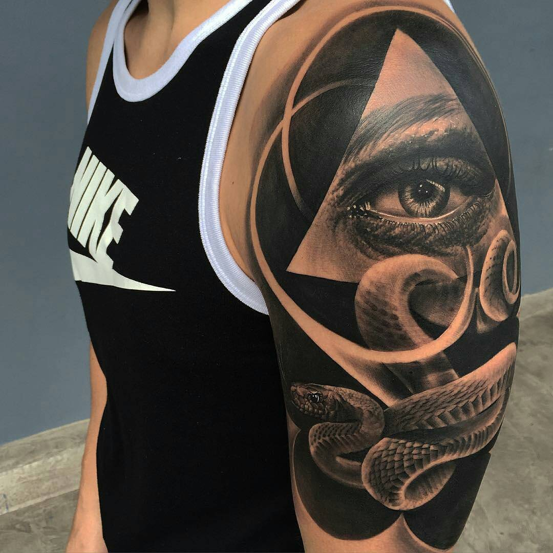 triangle eye and snake tattoo on shoulder