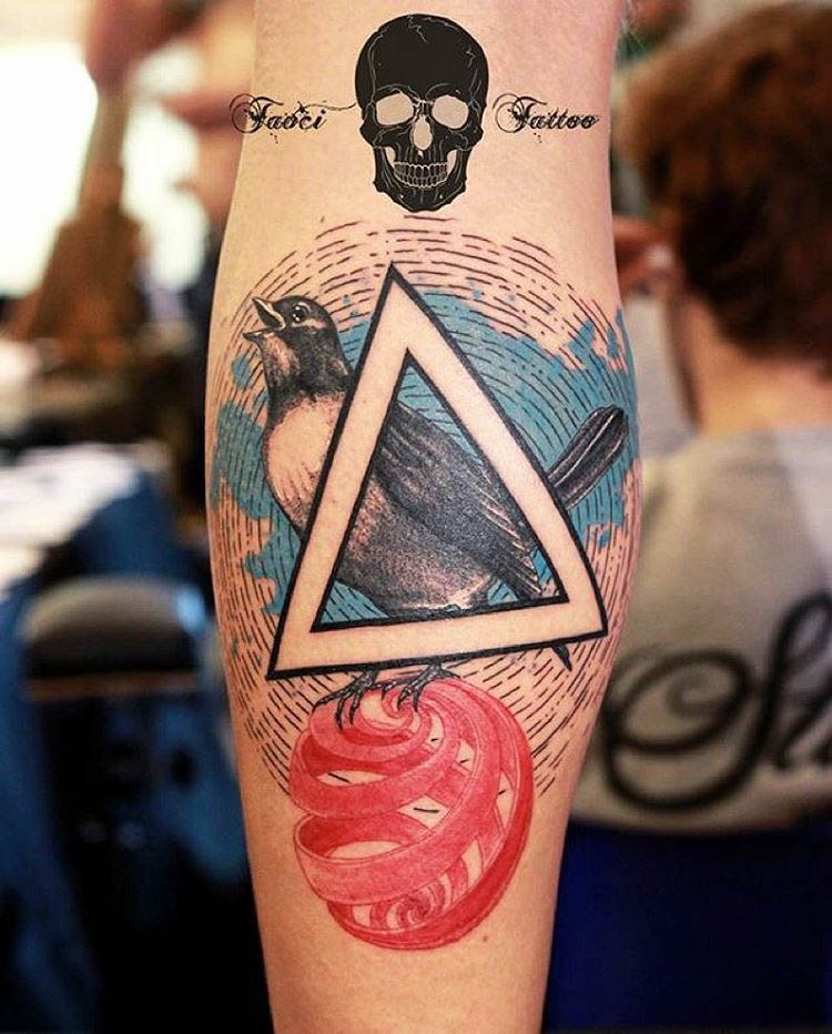 a bird tatoo arm