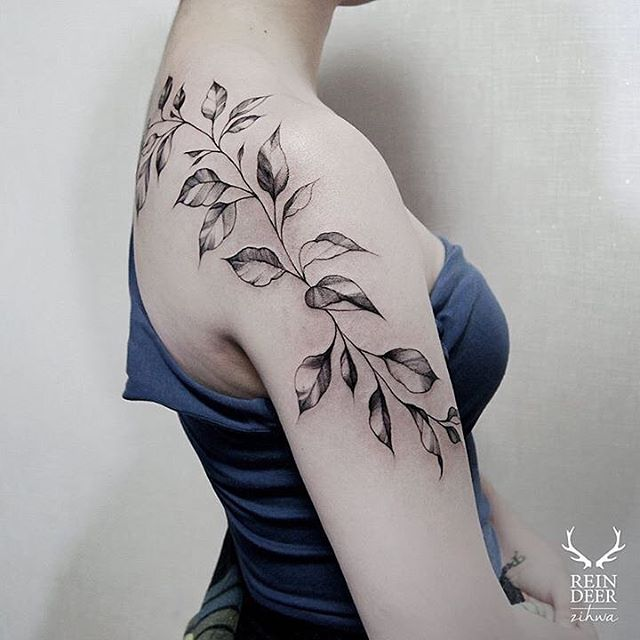 many leaves tattoo on shoulder and back