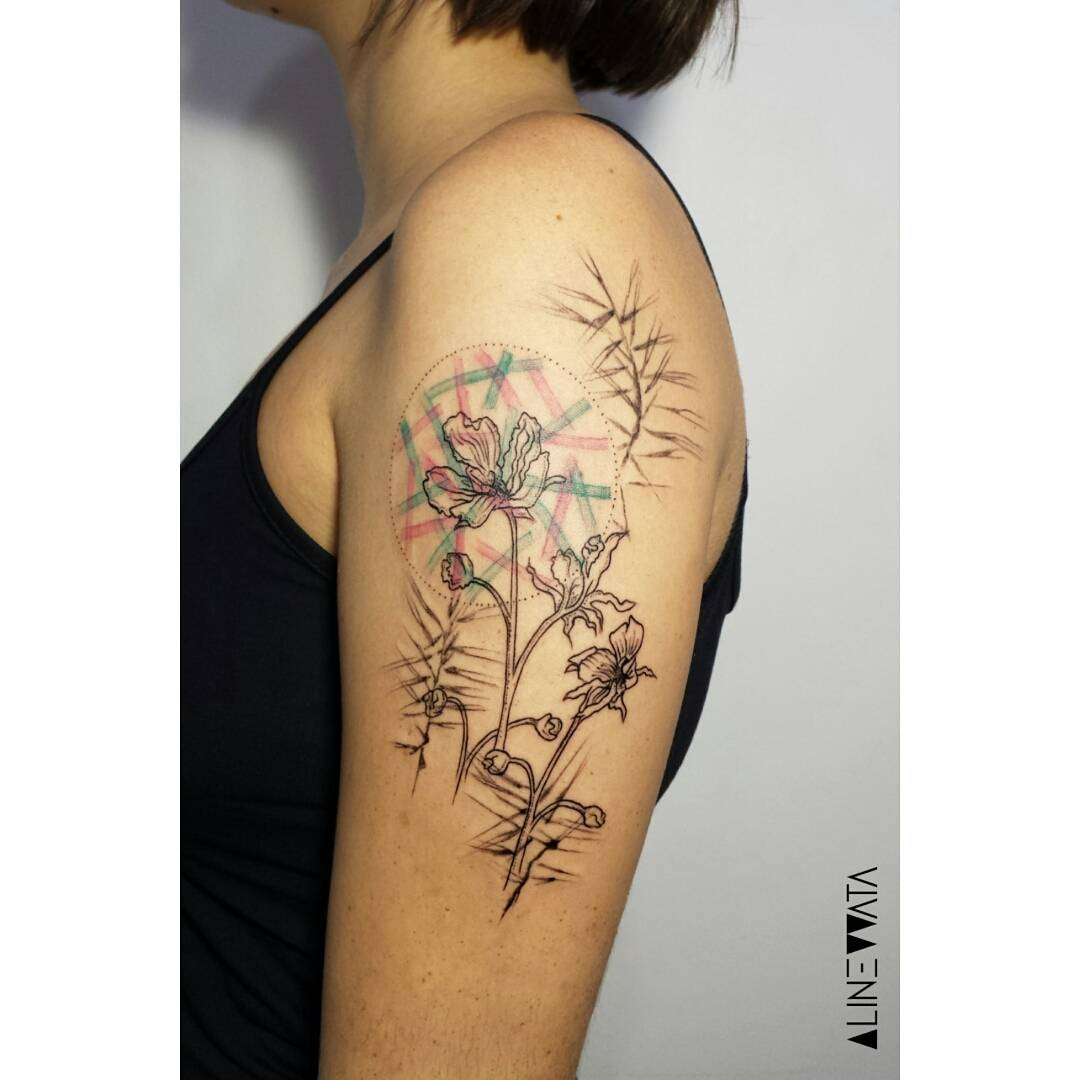 shoulder decorated with a tattoo of a rare for the art venus flytrap flower