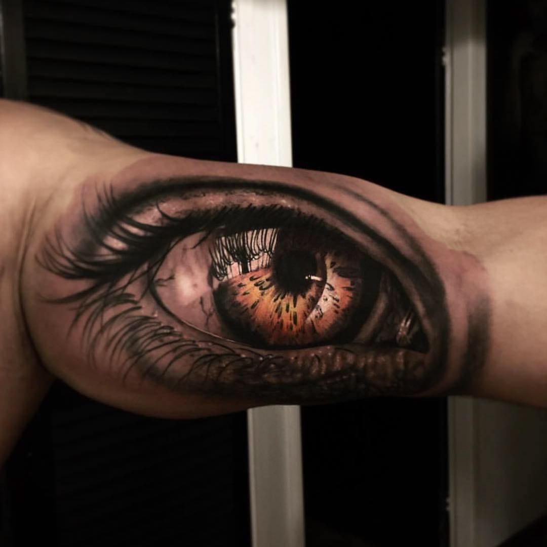 eye tattoo on bicep