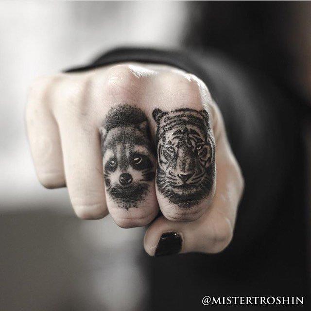 finger tattoos on animals