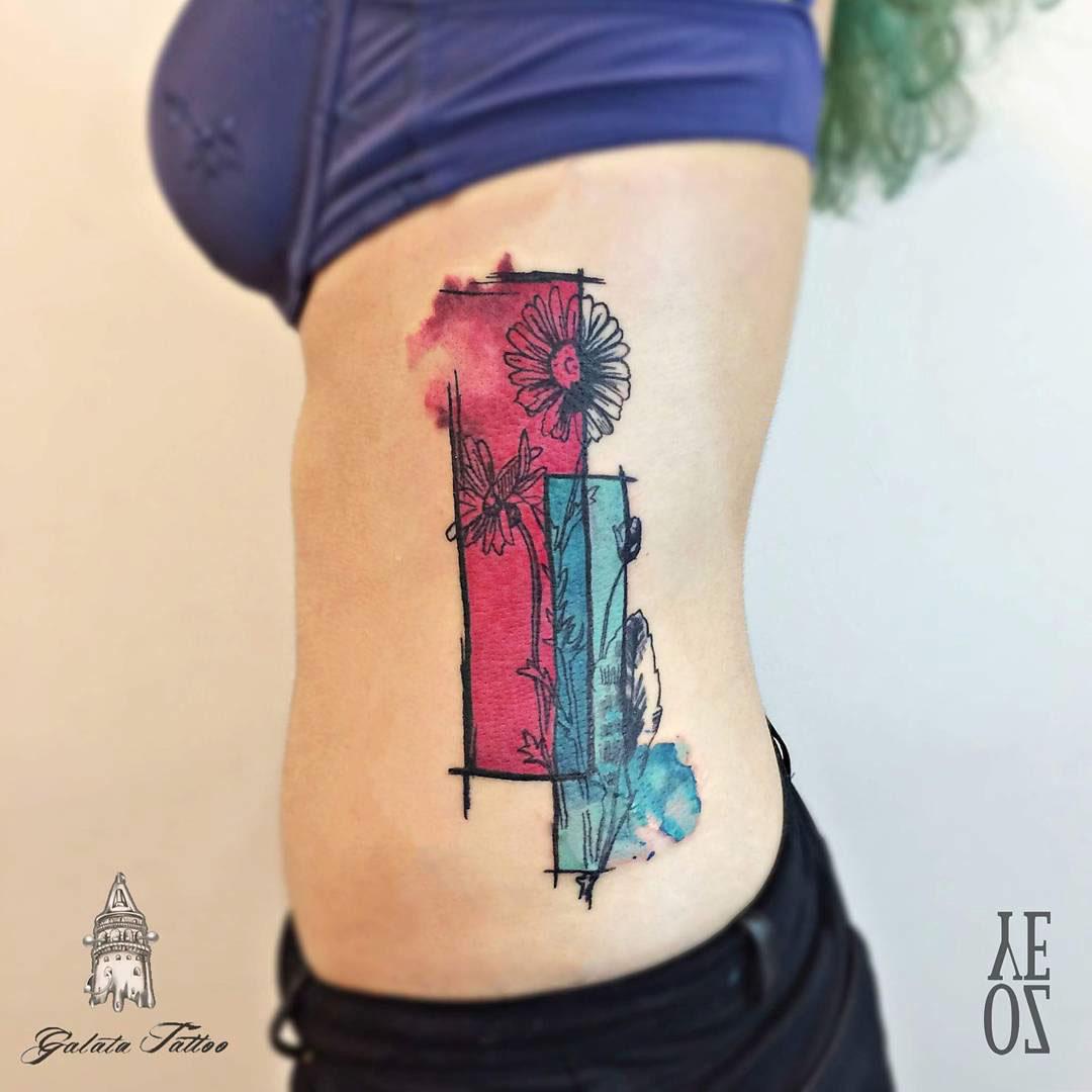 girl flower tattoo on side