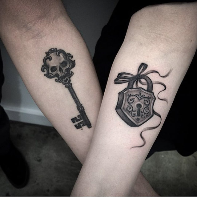 key and lock couple tattoos on arms