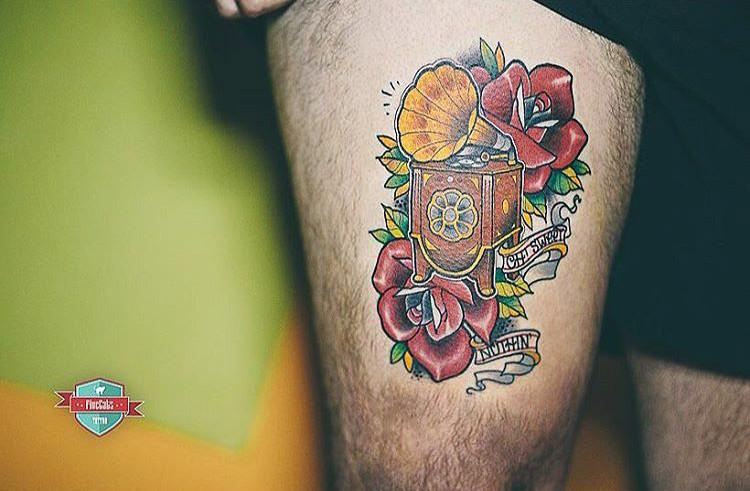 thigh neo-traditional gramophone tattoo