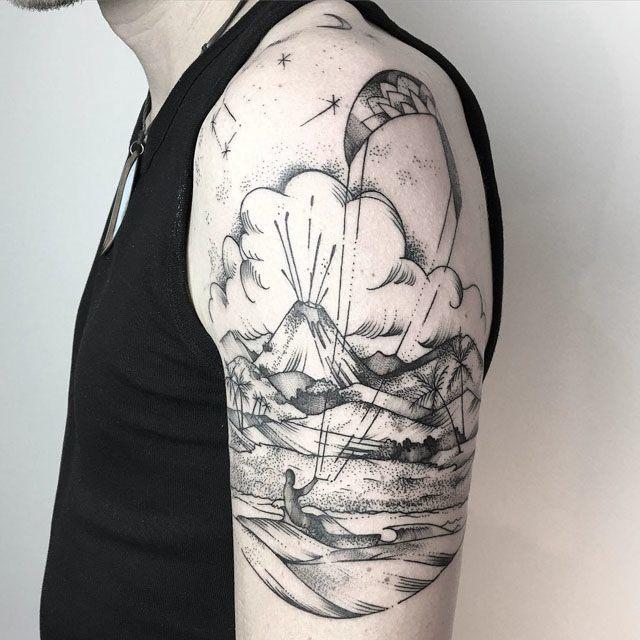island tattoo on shoulder