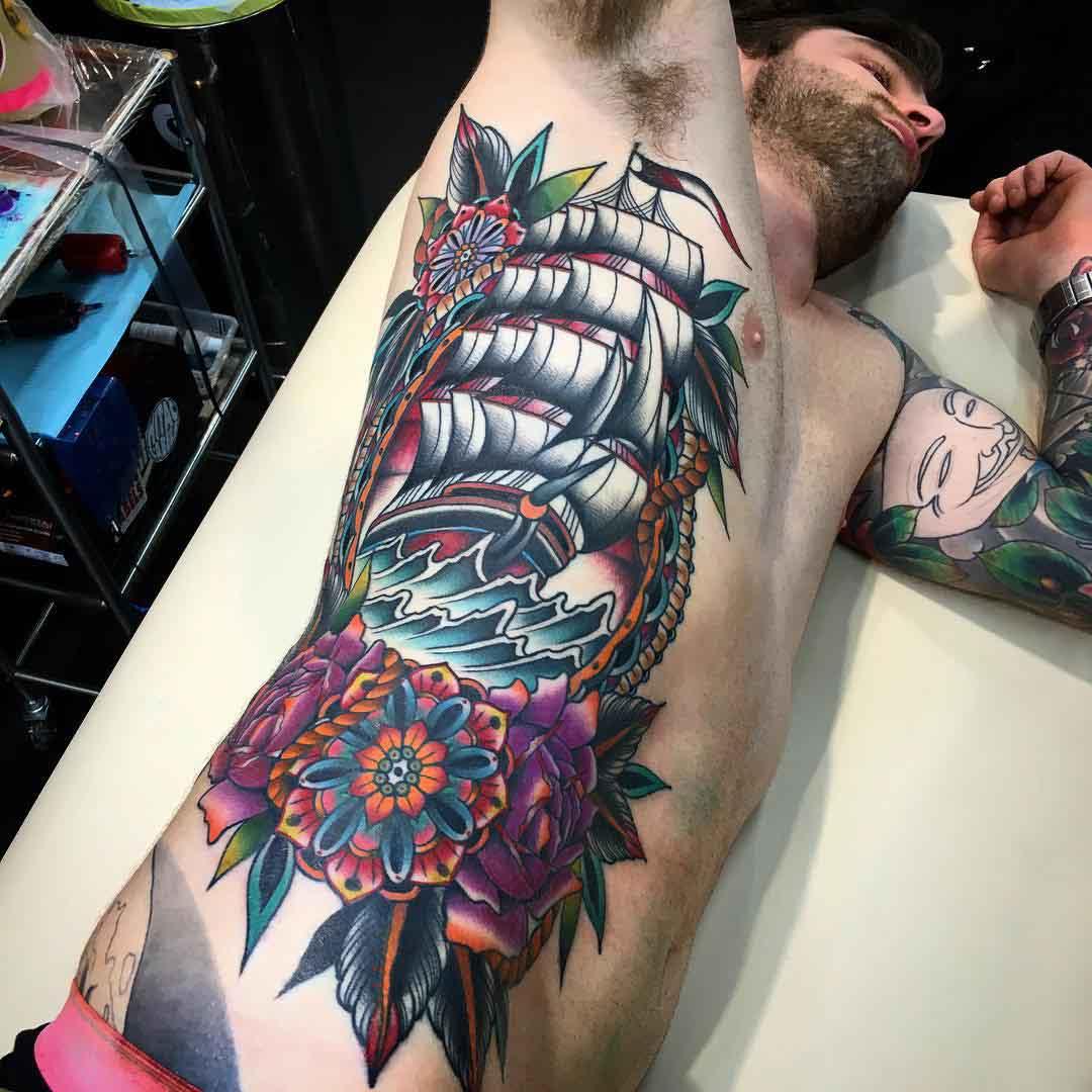 big nautical tattoo on torso side