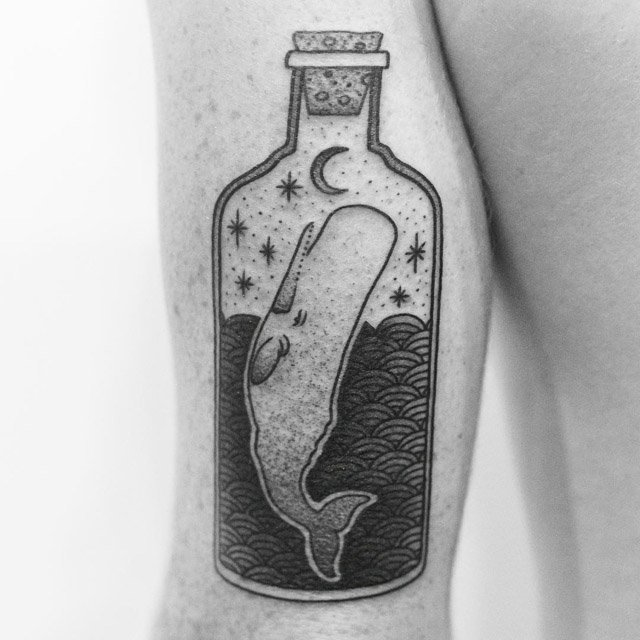 arm tattoo of wahle in bottle
