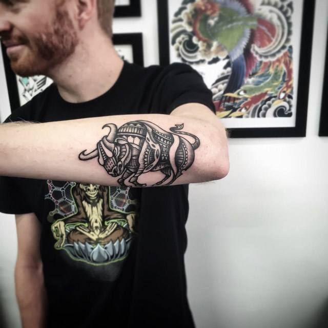 outer forearm bull tattoo