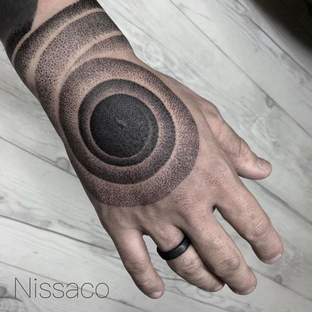 dotwork spiral tattoo on hand