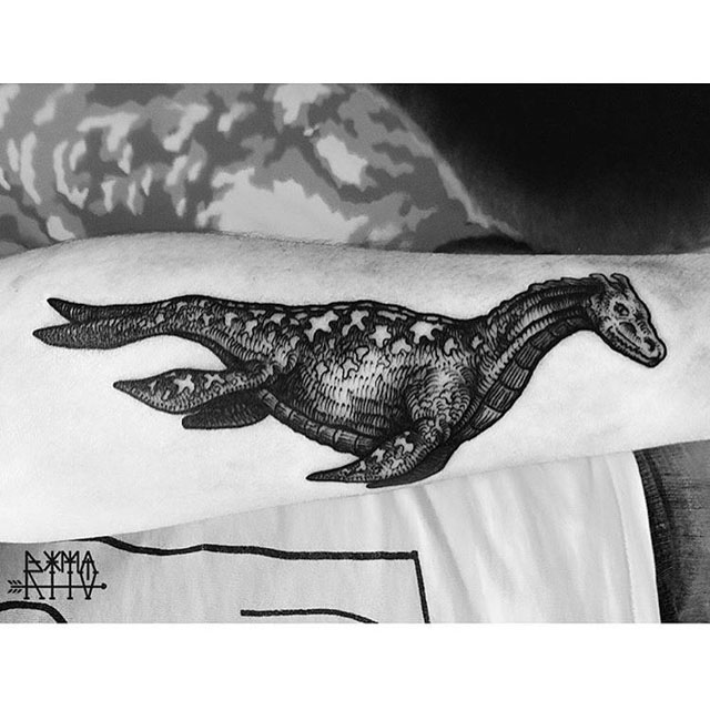 dragon tattoo on arm