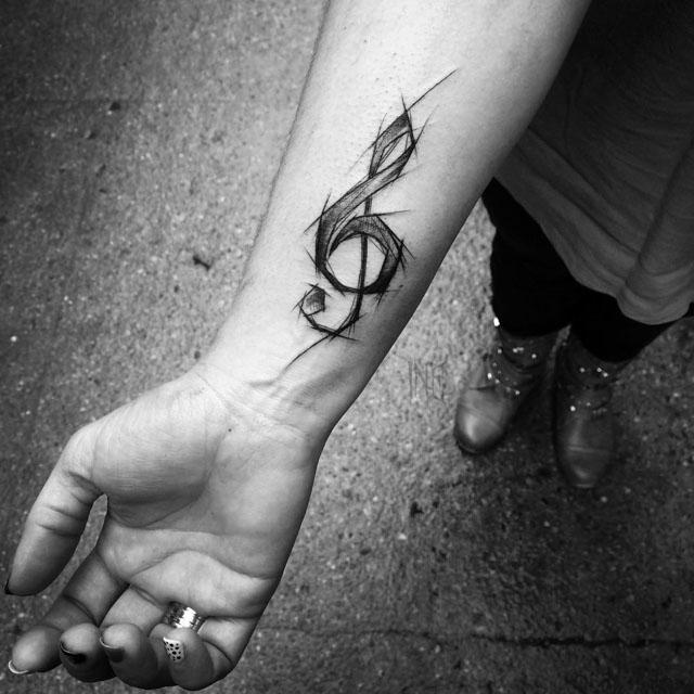 wrist treble clef tattoo