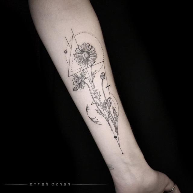 camomile tattoo on forearm