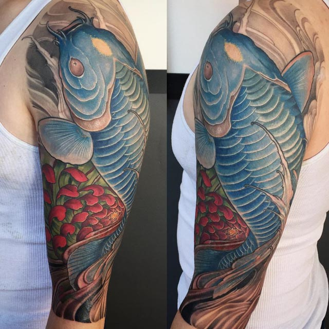 blue koi fish tattoo on shoulder