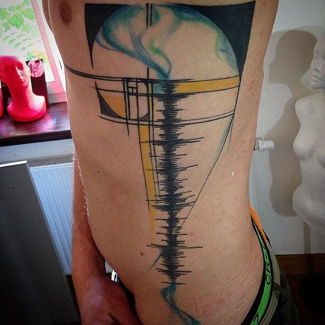 body side musical wave tattoo